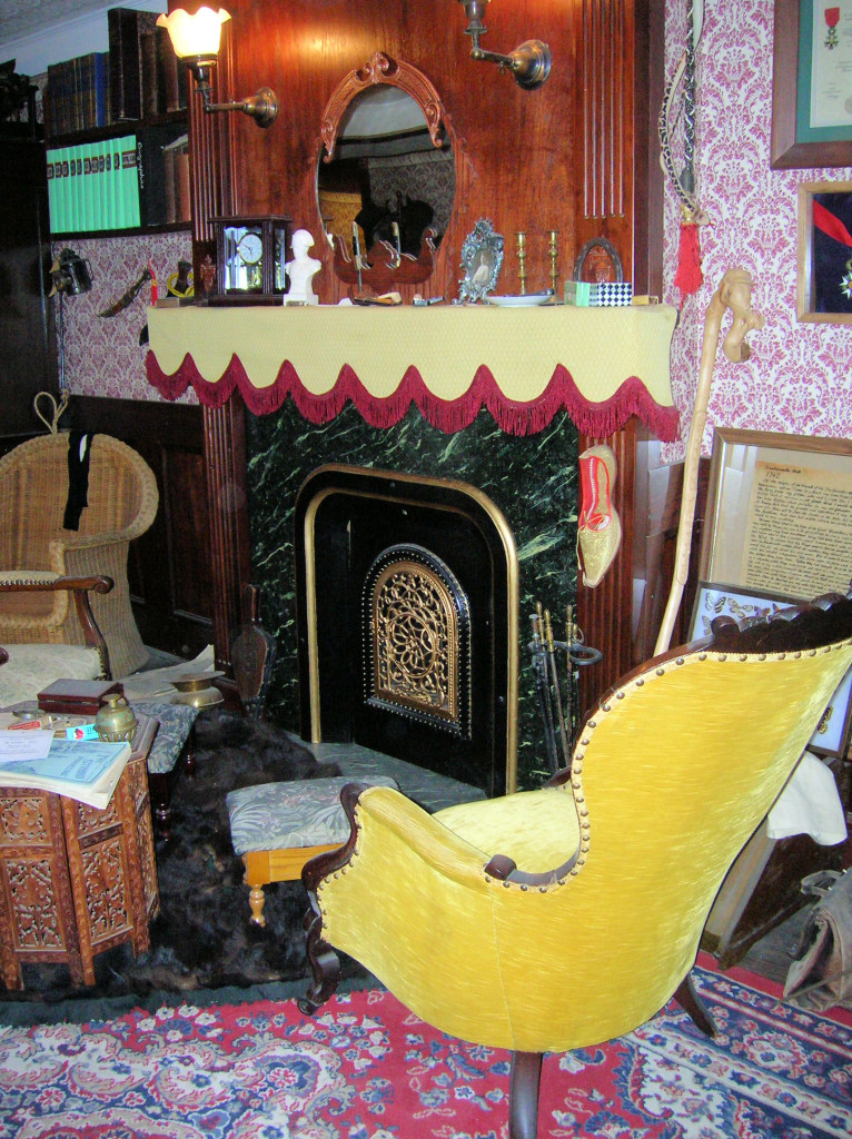 Holmes chair, next to the fireplace, complete with Persian slipper ~ 221B in Reading