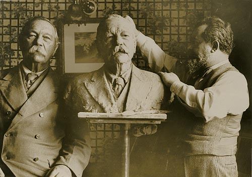Jo Davidson at work on his bust of Arthur Conan Doyle in 1930