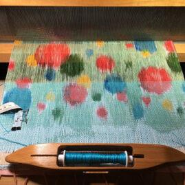 Sheila O'Hara weaving on painted warp
