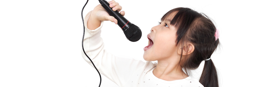 Girl singing during voice lessons at Scherzo Music School in San Mateo