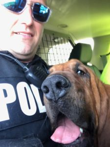 Tuscumbia PD Officer John Woodrum and bloodhound Eli