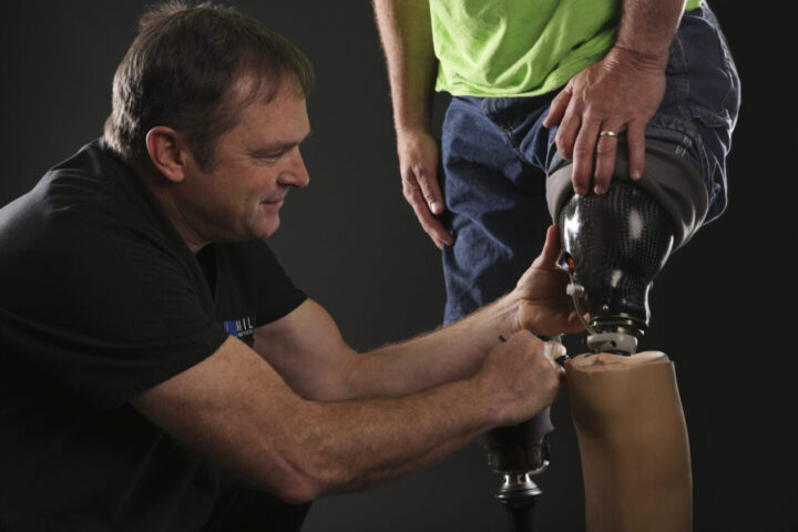Mark Miller, Certified Licensed Prosthetist adjusts high tech prosthetic leg