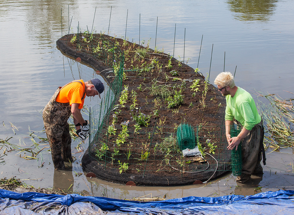 Workers prepare one of the islands for launching.