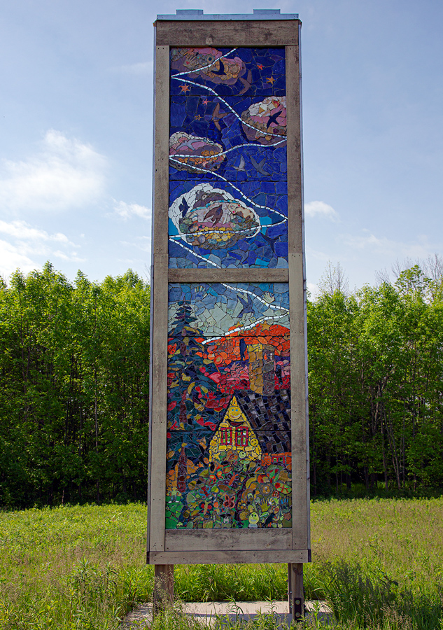 One side of swift tower showing colorful tile mural