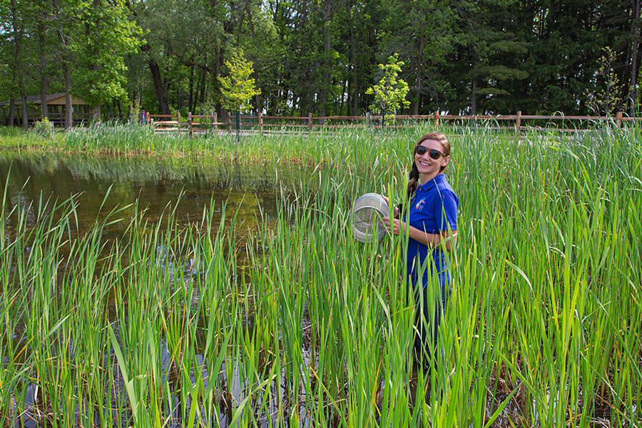 young woman in wetland with trap
