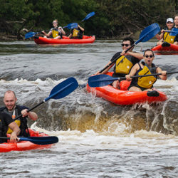 four rafts going over falls on the Milwaukee RIver