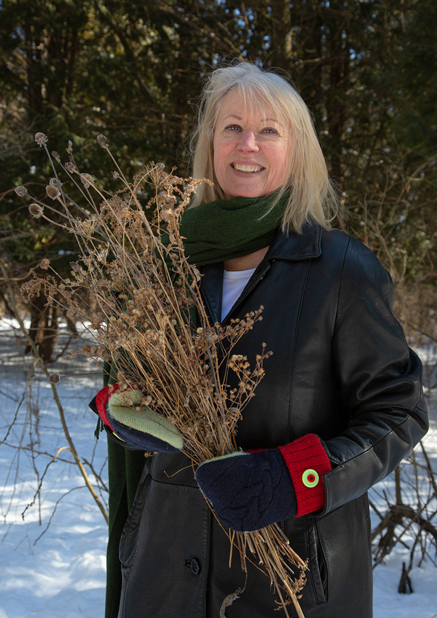 Tori Tasch with collected seed specimens.