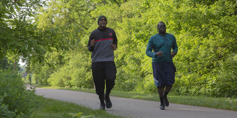 Two men running on Menomonee River Parkway
