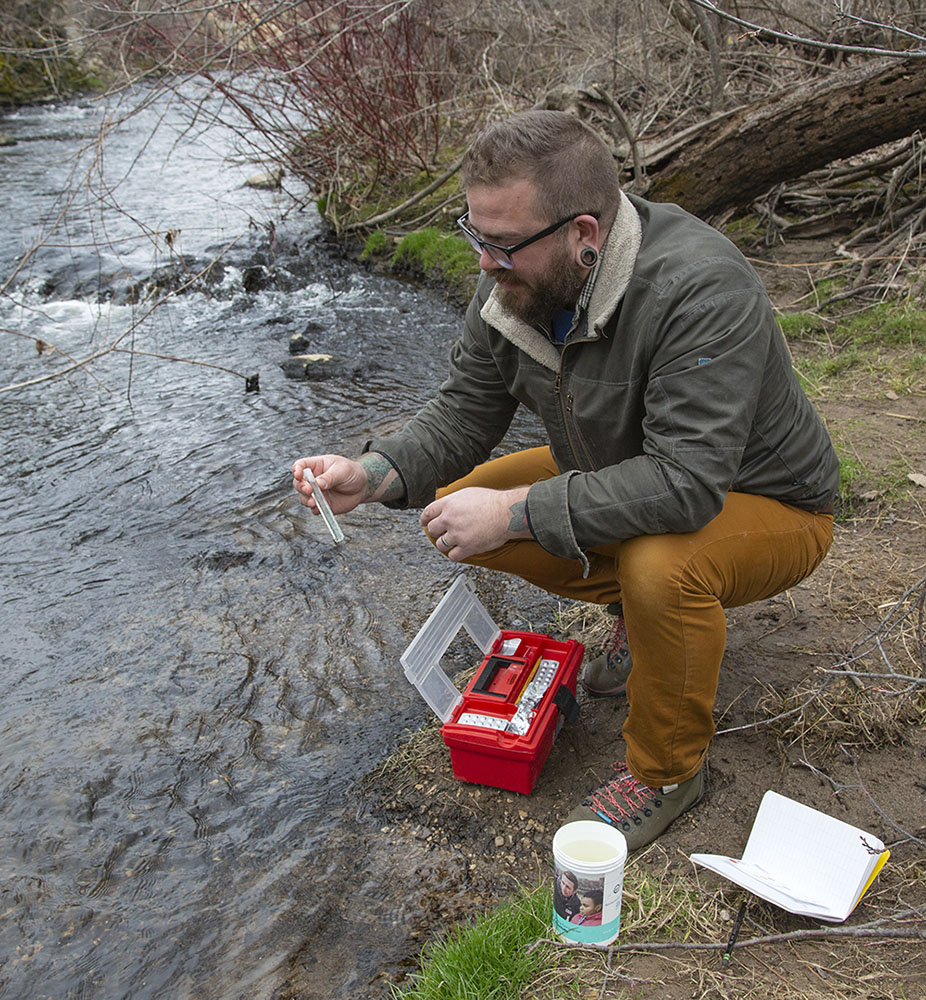 Devon testing the creek water for phosphorus