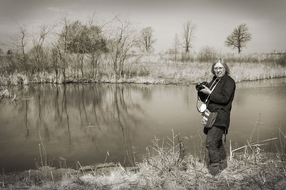 Vicki Reed overlooking a pond at Forest Beach