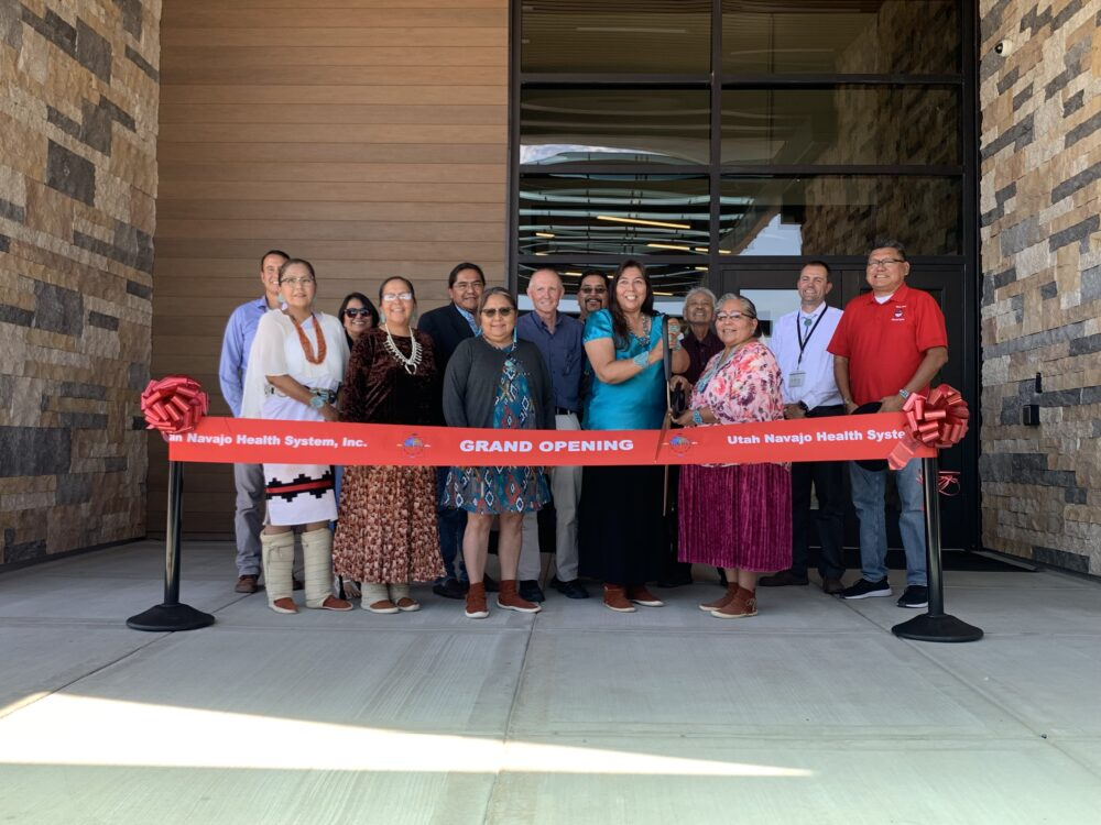 Board members and UNHS leadership gather for the ribbon cutting ceremony
