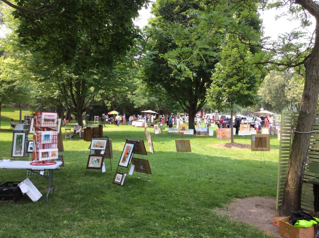 Paintings on display in the park.
