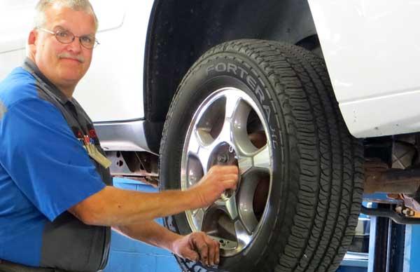 Martin Automotive Mechanic Replacing a Tire