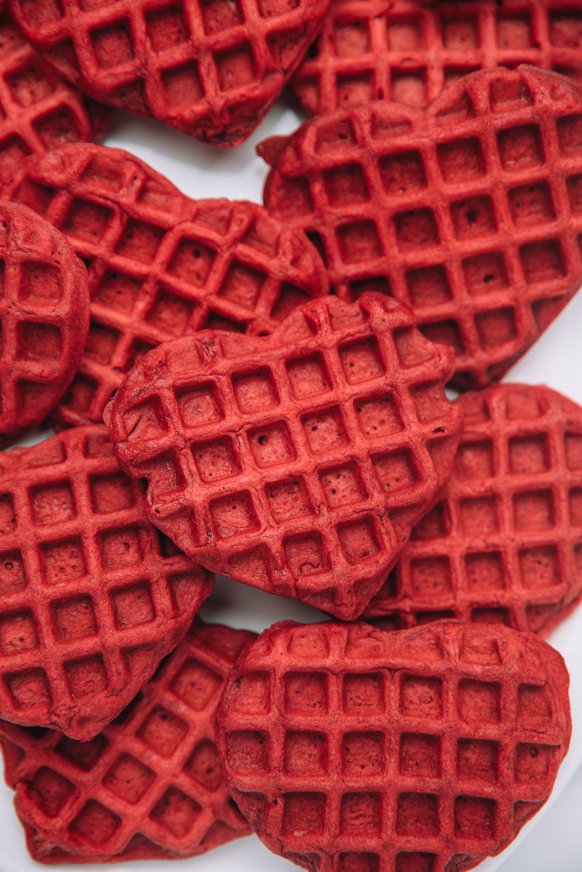 A batch of Buttermilk Red Velvet Waffles in a white dish