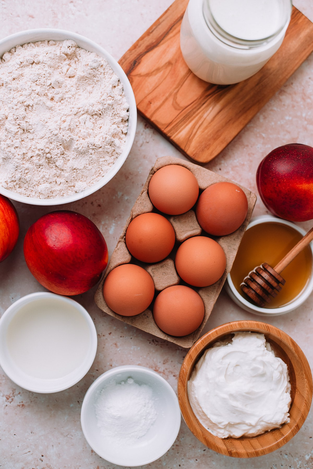 Ingredients for Whole Wheat Pancakes with Yogurt and Nectarines on a table