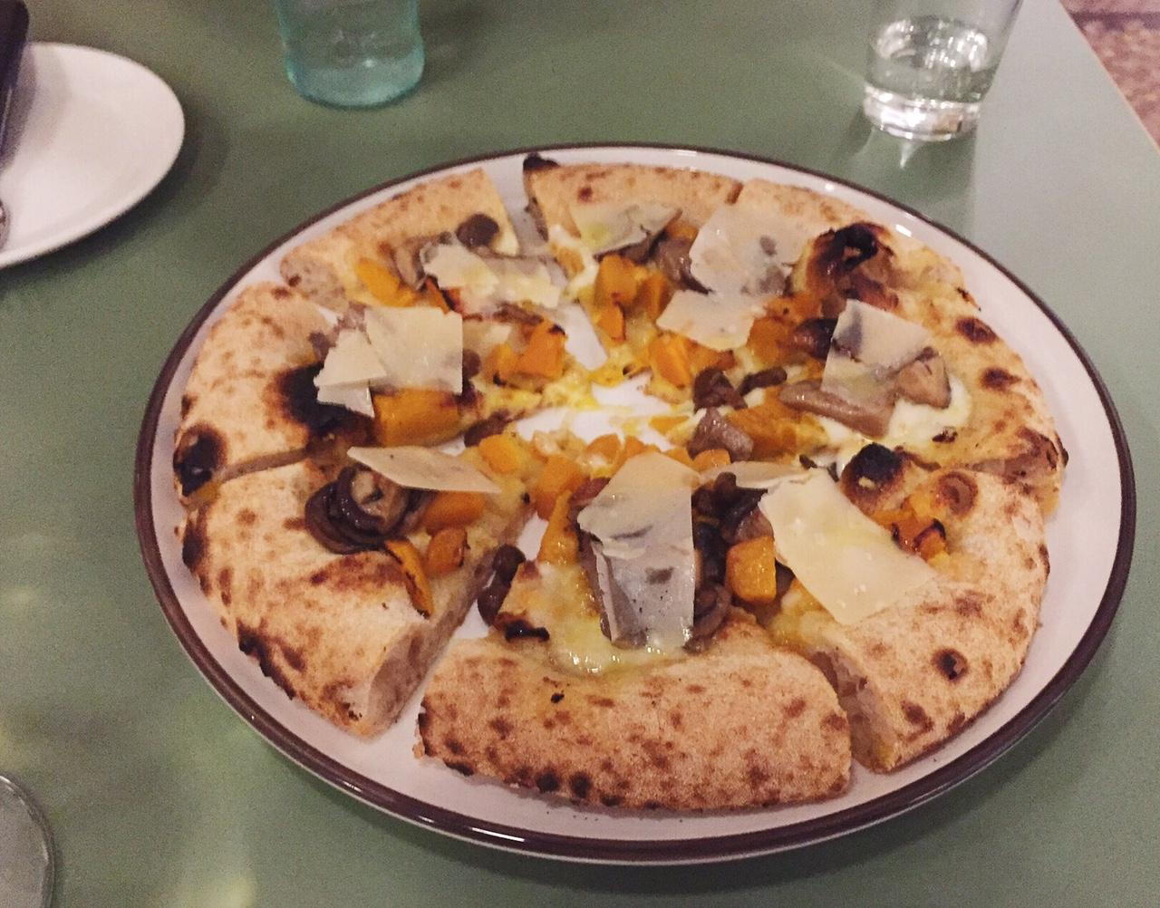 Berbere pizzeria in Milan pumpkin, mushrooms, and parmesan