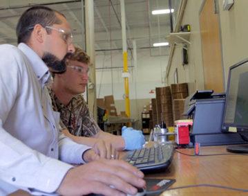 Aquest Machining computer team photo