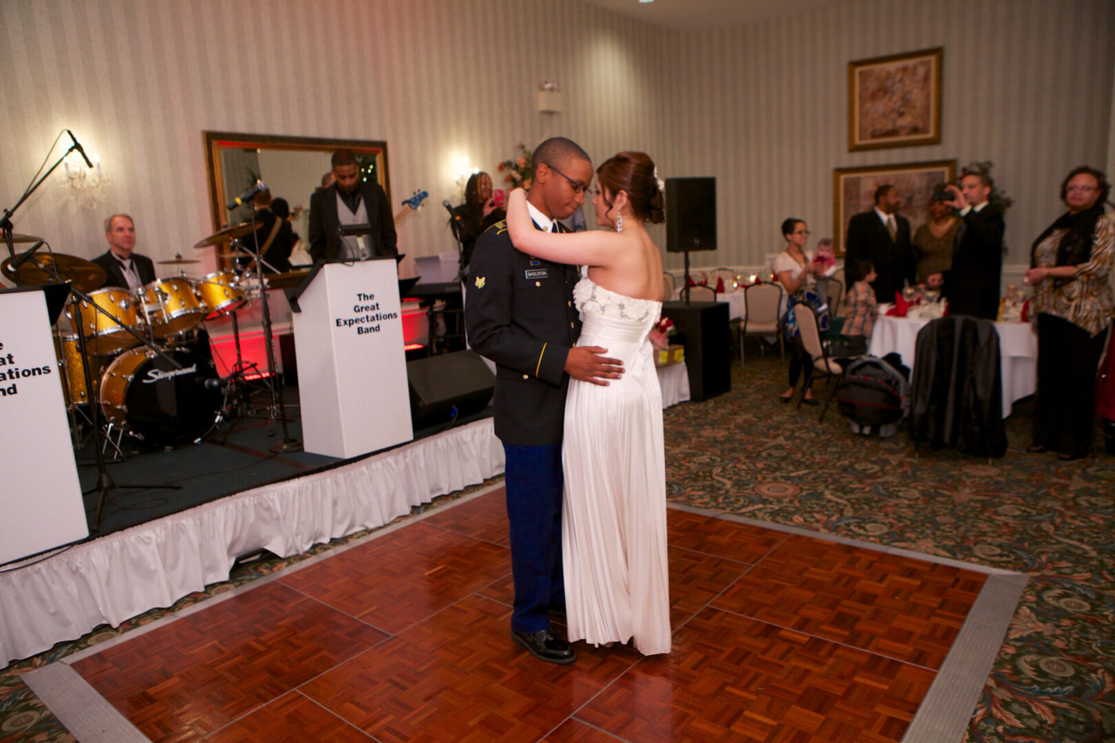 a bride and groom dancing together