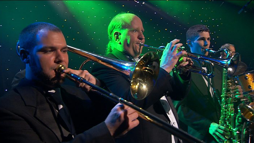 three men playing different wind instruments