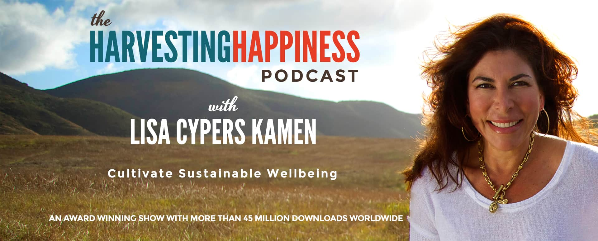 Lisa Cypers Kamen with green mountains and a blue sky behind - harvesting happiness