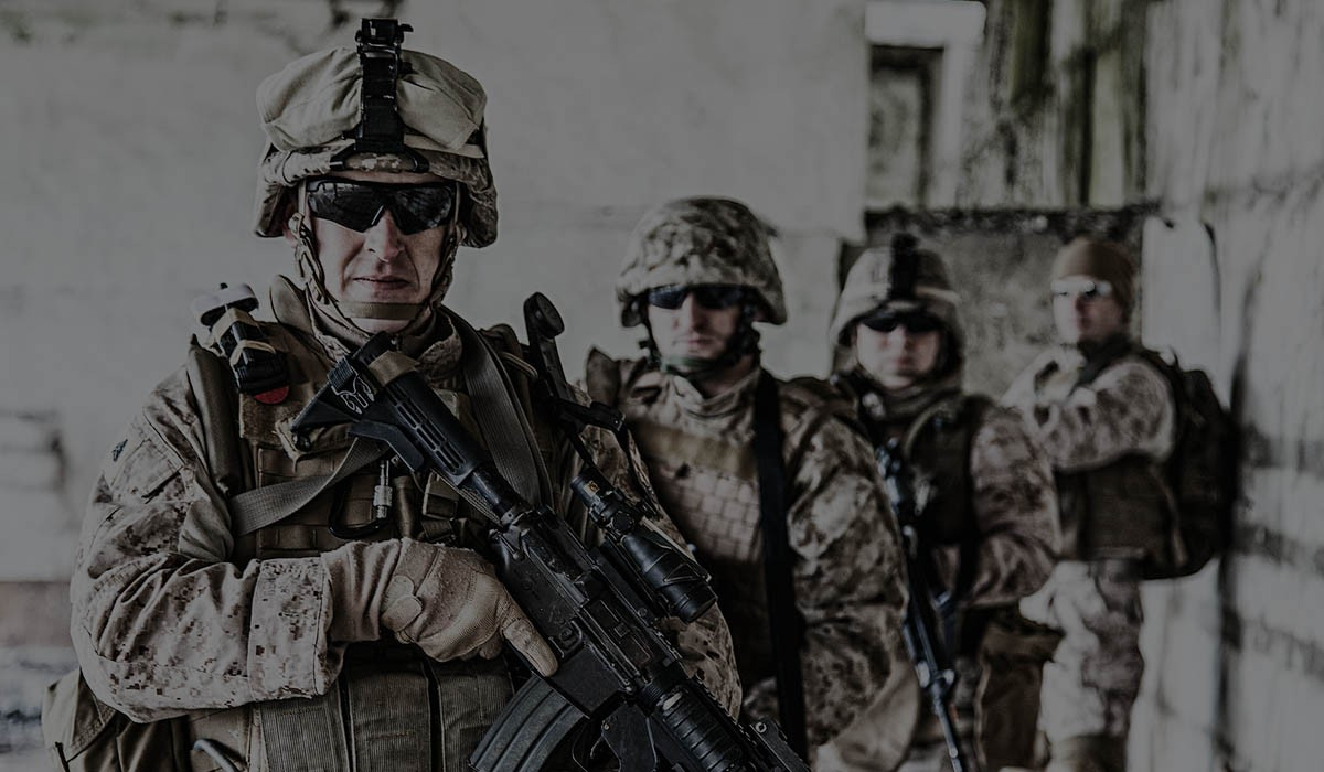 picture of four soldier with guns