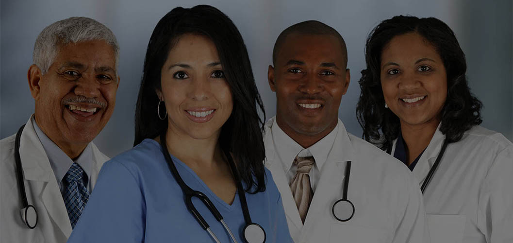 picture of two female and two male doctors greeting each other