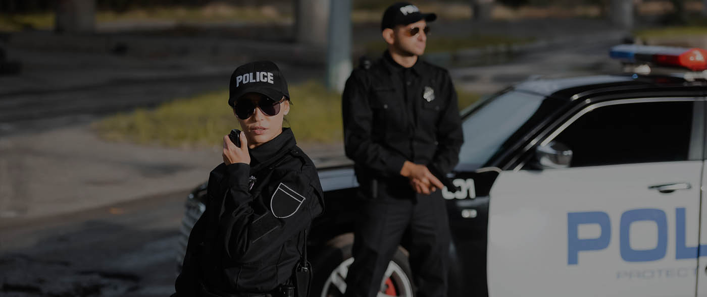 A picture of a police woman and a police man
