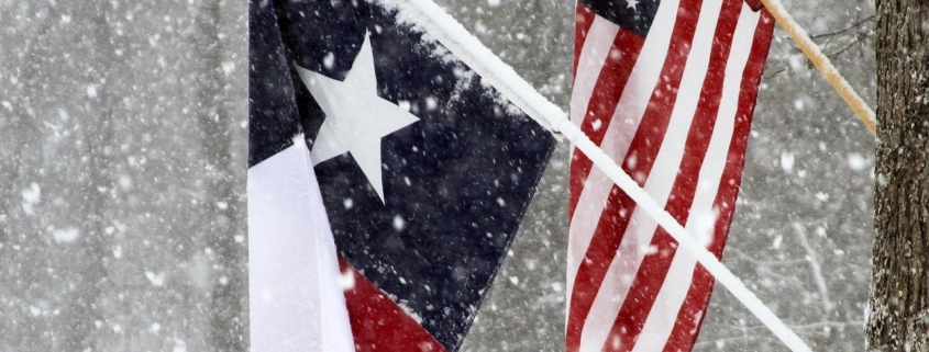 Texas and USA flags in snow