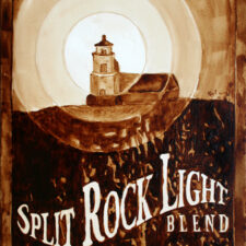 "Andrew Saur & Angel Sarkela-Saur created this ""Split Rock Light Blend"" Coffee Art painting featuring a beam of light emanating from Split Rock Lighthouse."