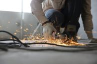 Protect your employees after lockdown – organizational change management consultant - construction worker holding a grinder