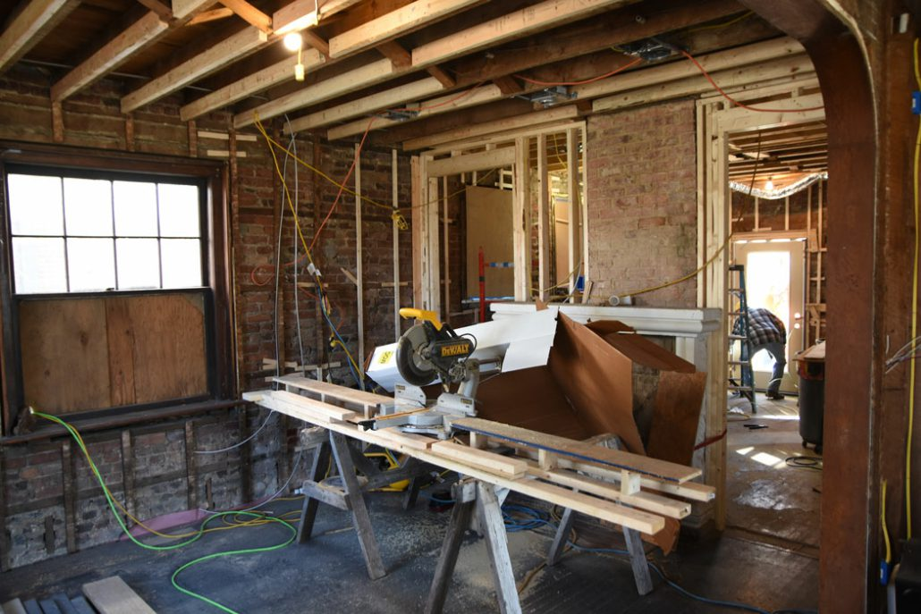 saw horses are set up in a room of the Stone House during the renovation