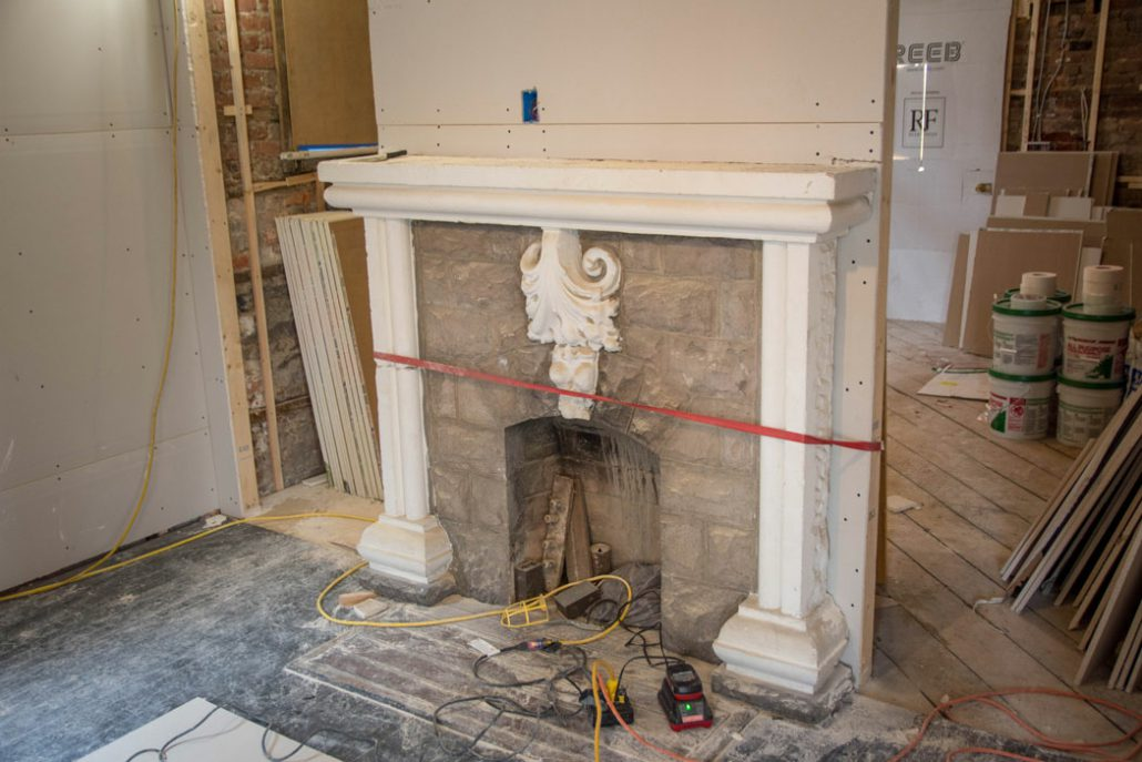 a fireplace at the Stone House in the process of being restored