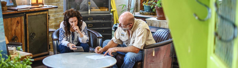 Jeff Ellis talks to a customer about a custom design job