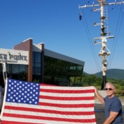 a larger American flag outside of Ballast Point Brewing Company