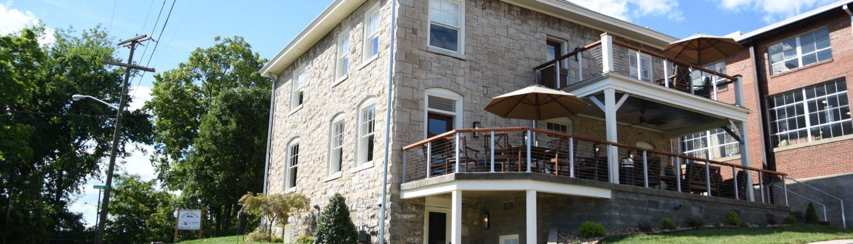 The backyard balconies of Black Dog Salvage's Stone House rental property