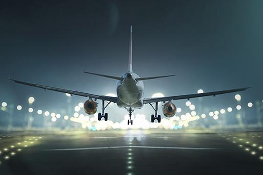 Airplane taking off at night