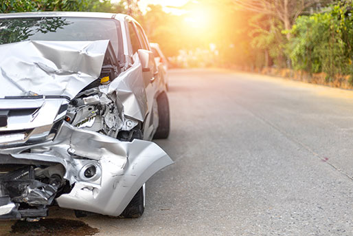 Gray car badly damaged in an accident