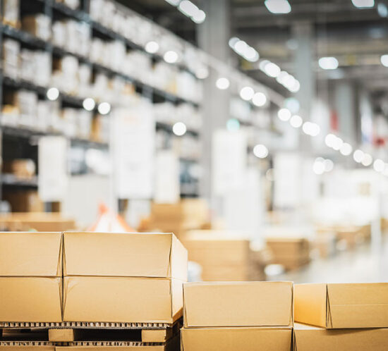Blurred out photo of boxes in a shipping warehouse
