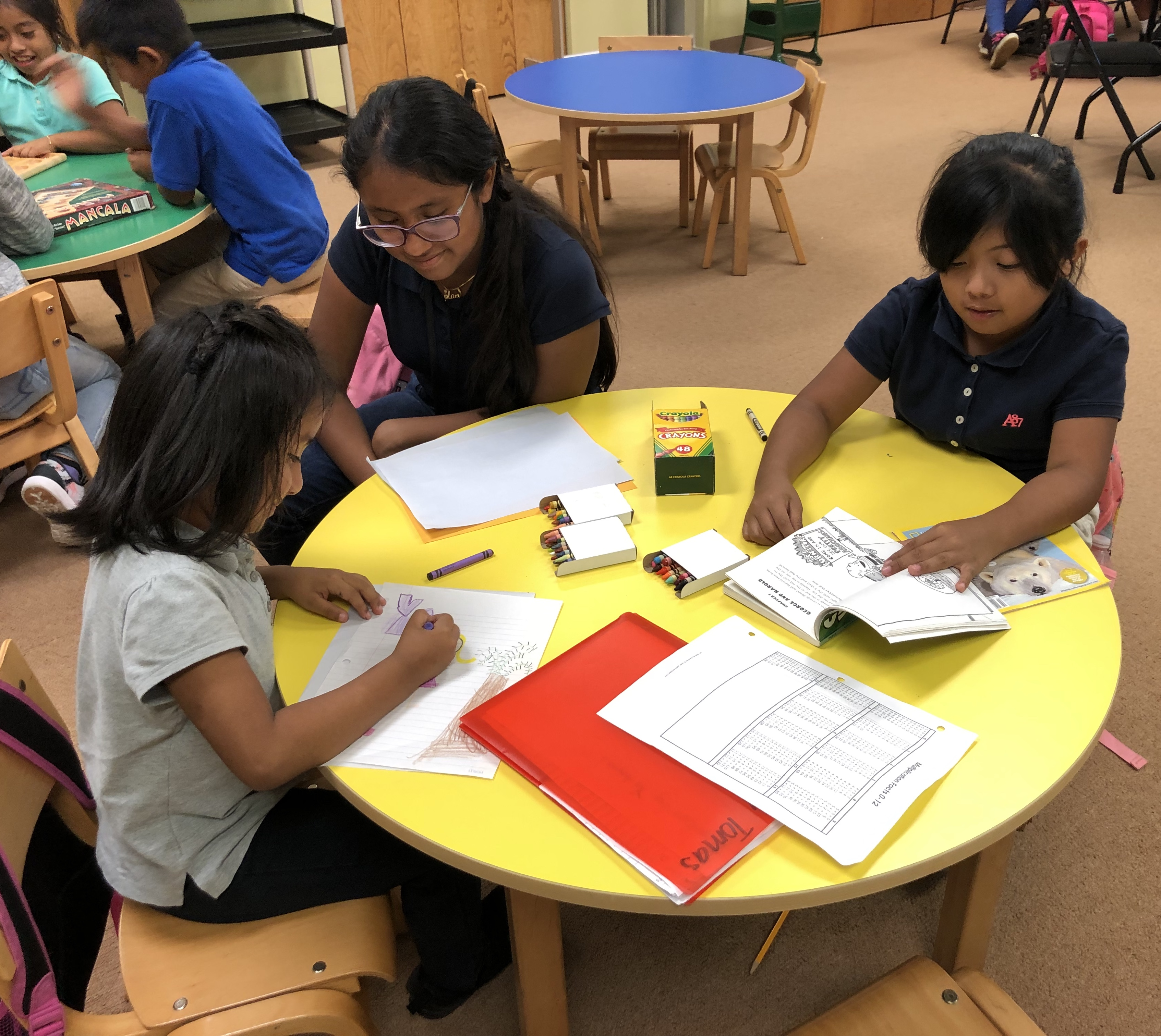 holycross-kids-drawing-at-table