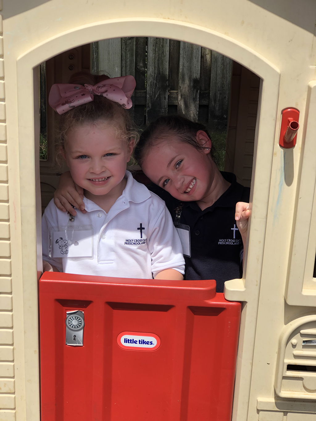 holycross-two-girls-smiling-in-playground-house