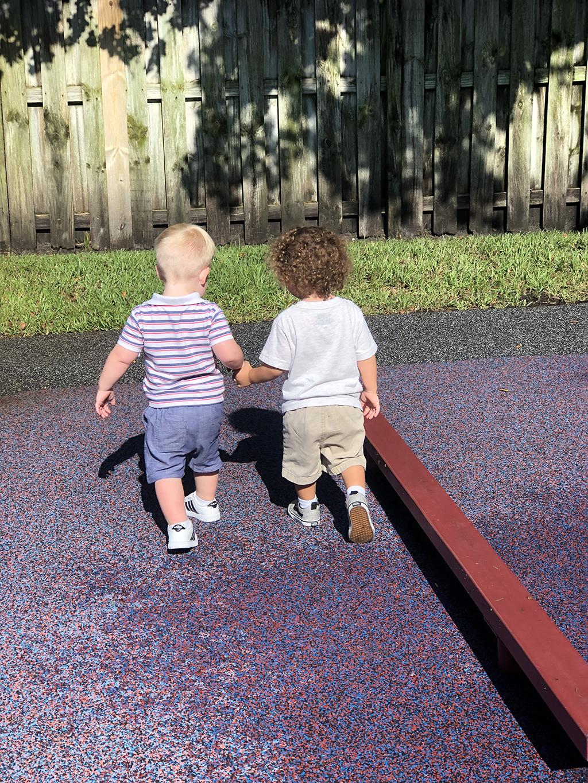 holycross-two-kids-holding-hands