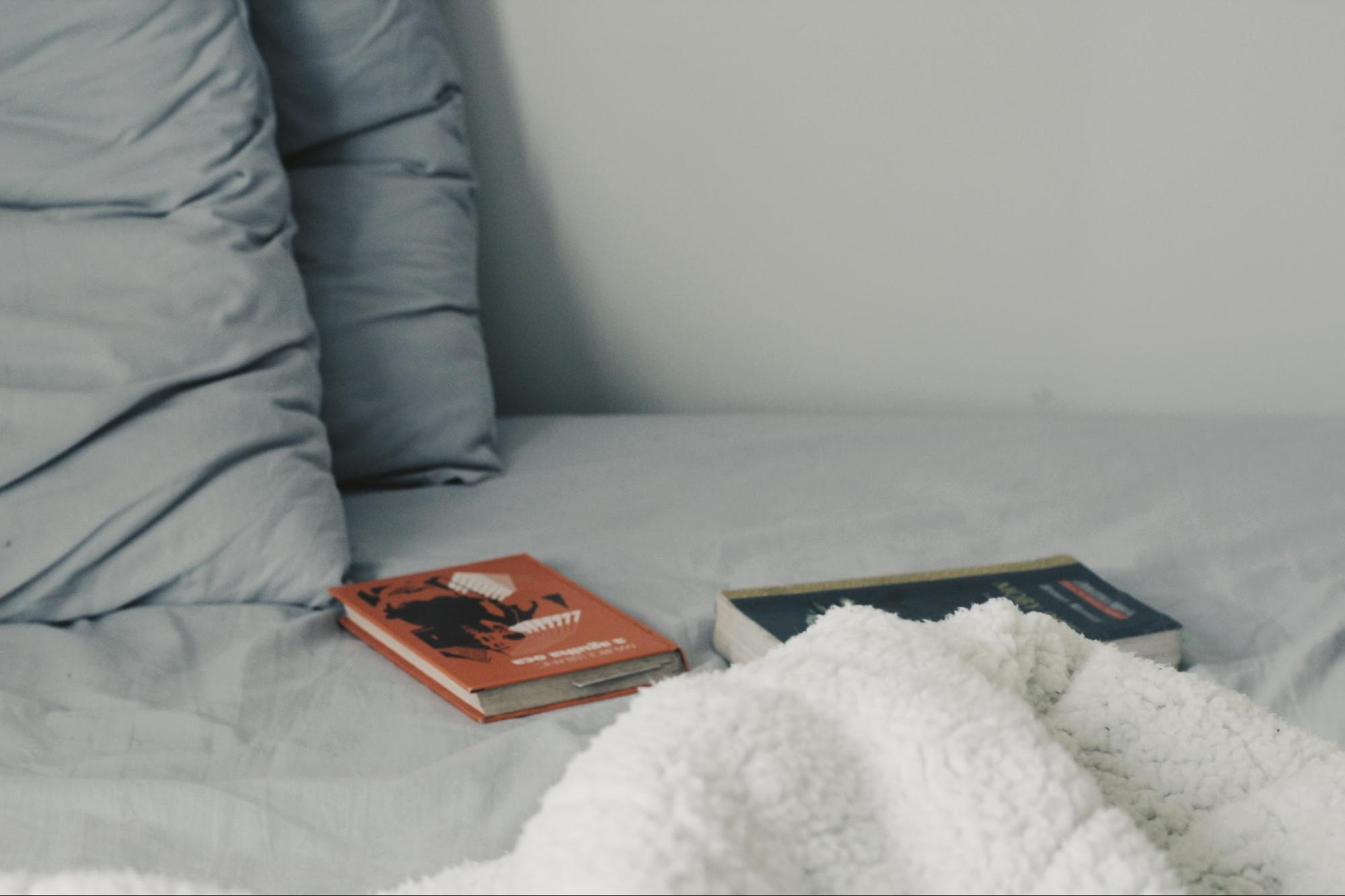 books instead of phone on a bed