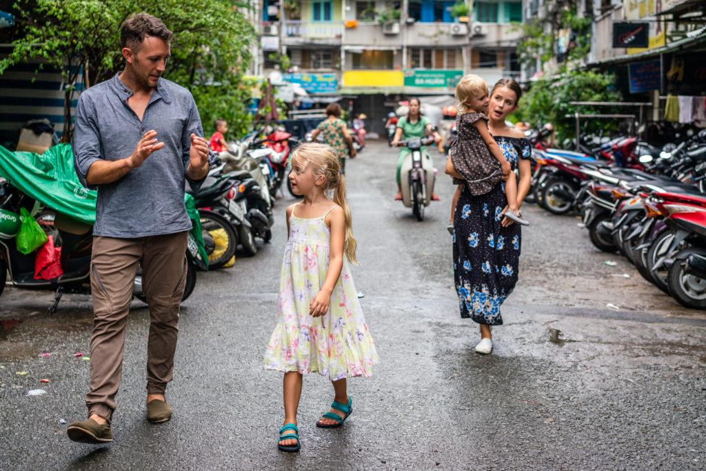 Joel, Janna, Quinn and Romyn walking down the street in Vietnan