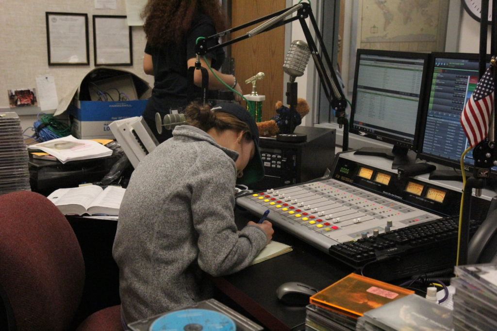 Jordan Hallemann, Music Director, plans out a show for the station.