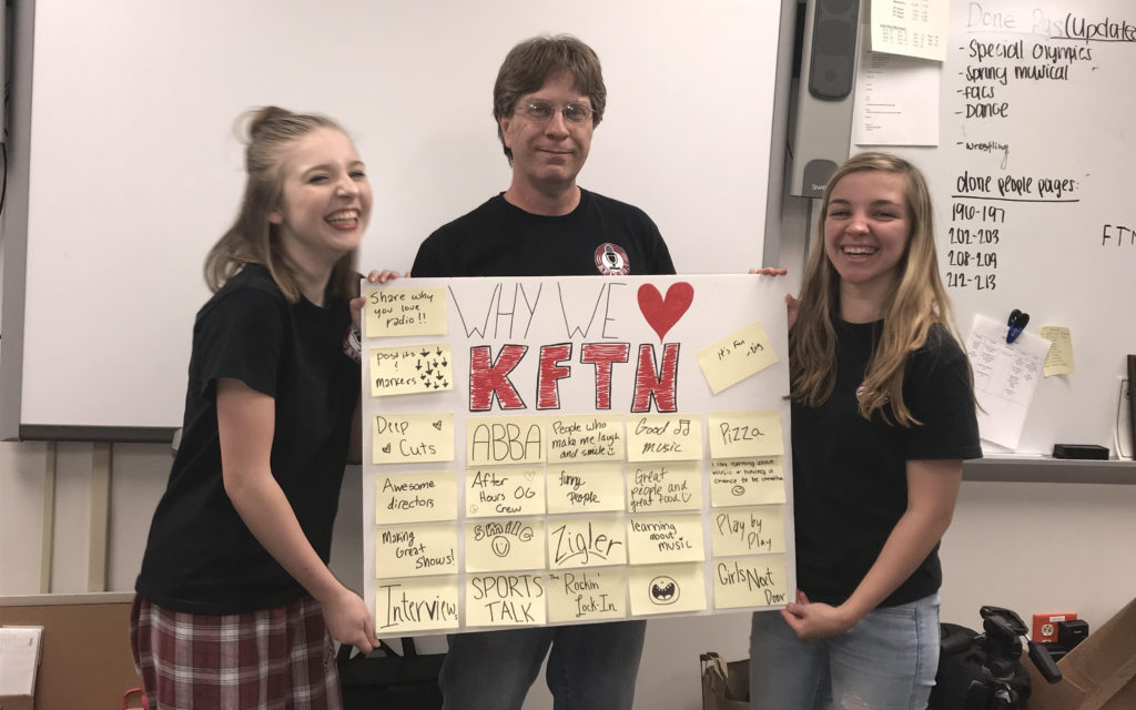 Katie Quinn and Kiki Wagner pose with Adviser, Clay Zigler.