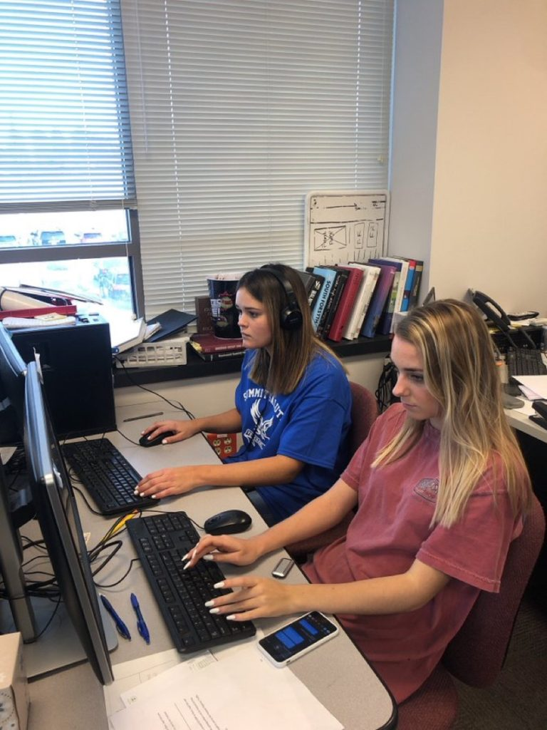 Station Manager Alexis Rotter and Operations Manager Lauren Brennecke prepping for the KFTN Rockin' Lock-In