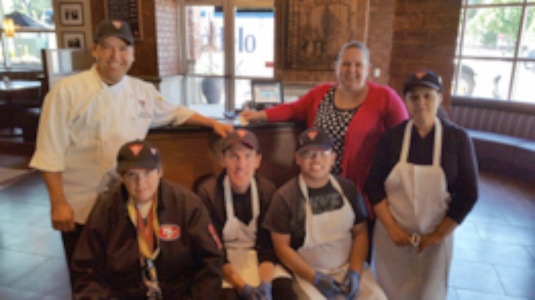 Debbie earns a paycheck with the GO work crew at BJs Brewhouse Restaurant