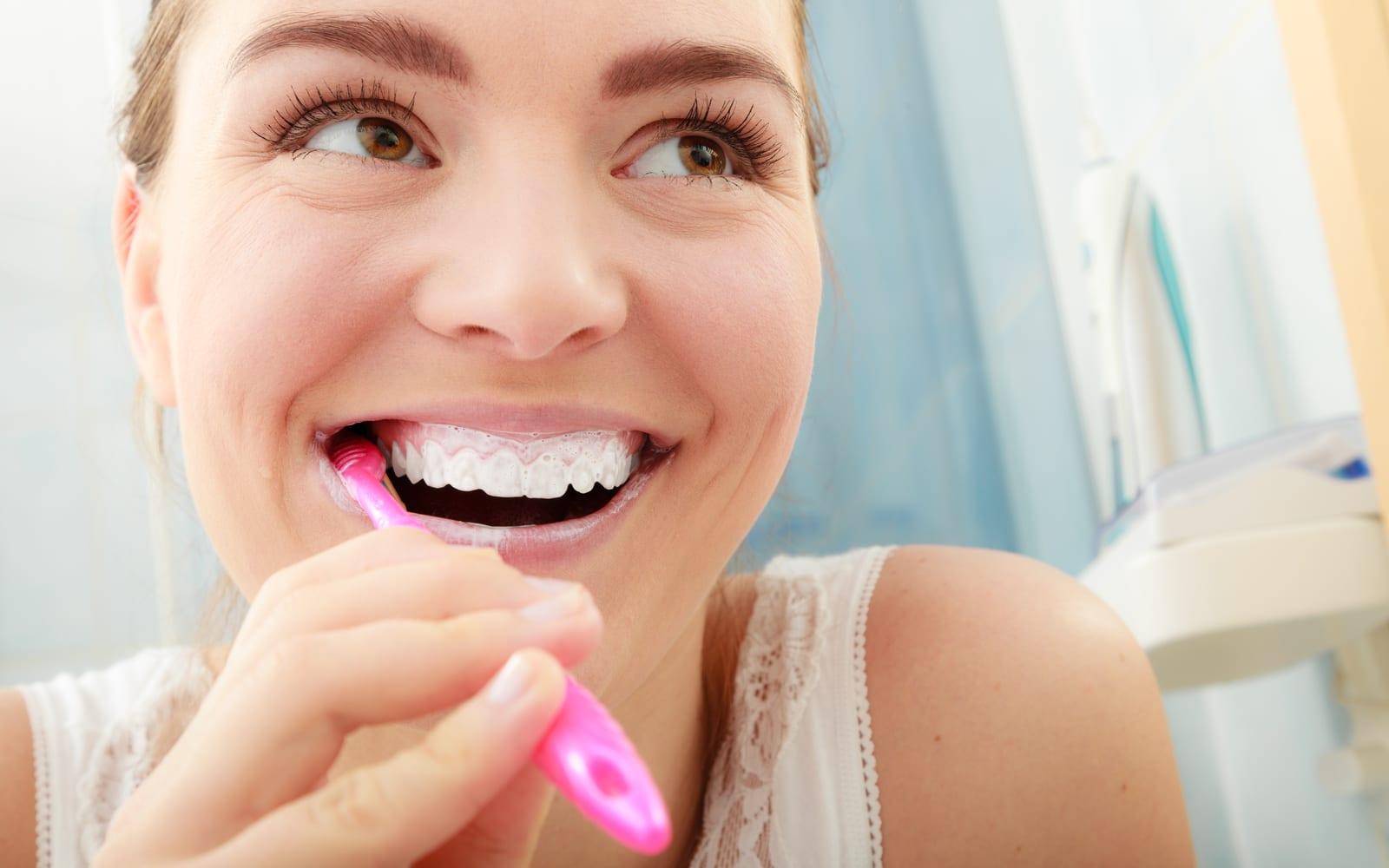 Woman smiling while brushing