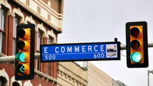funding for dropshipping blog feature image with ecommerce on street sign