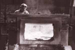 Historical photo of a foundry worker in the CXM plant.